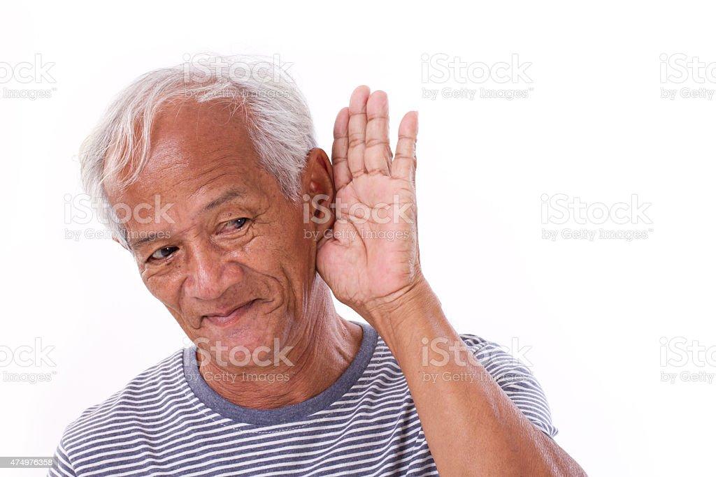 old man listening stock photo