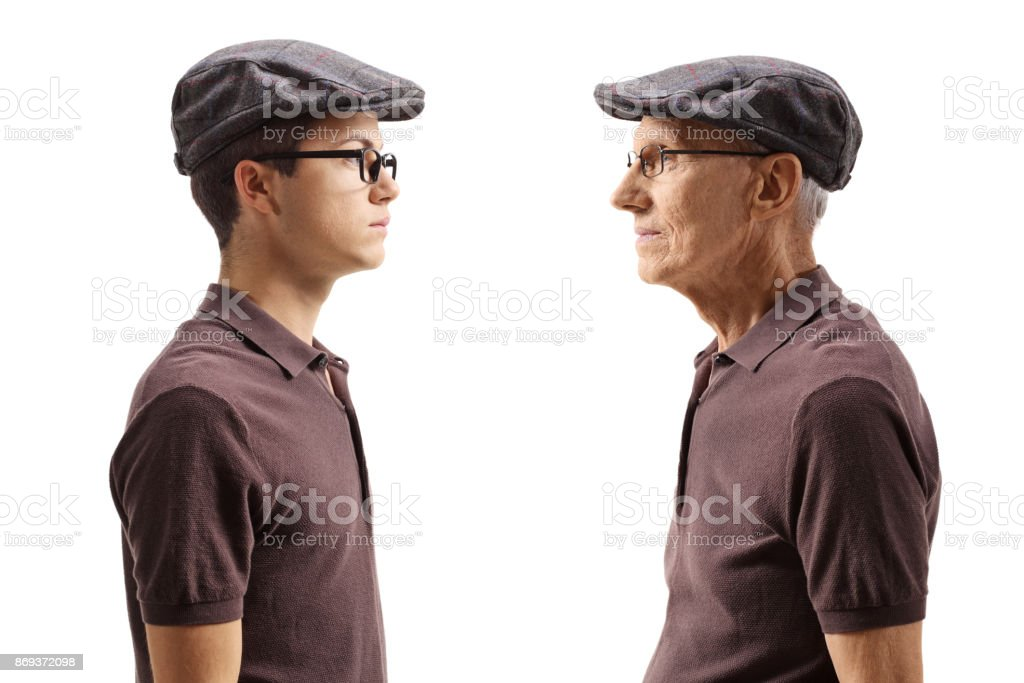 Old man looking at his younger self stock photo