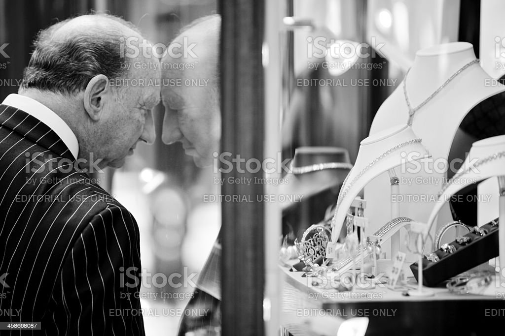 Old man looking at jewelry in the Burlington Arcade royalty-free stock photo