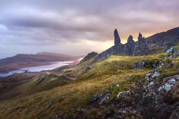 Old Man Of Storr, Isle of Skye Old man of Storr at sunset with dramatic clouds isle of skye stock pictures, royalty-free photos & images