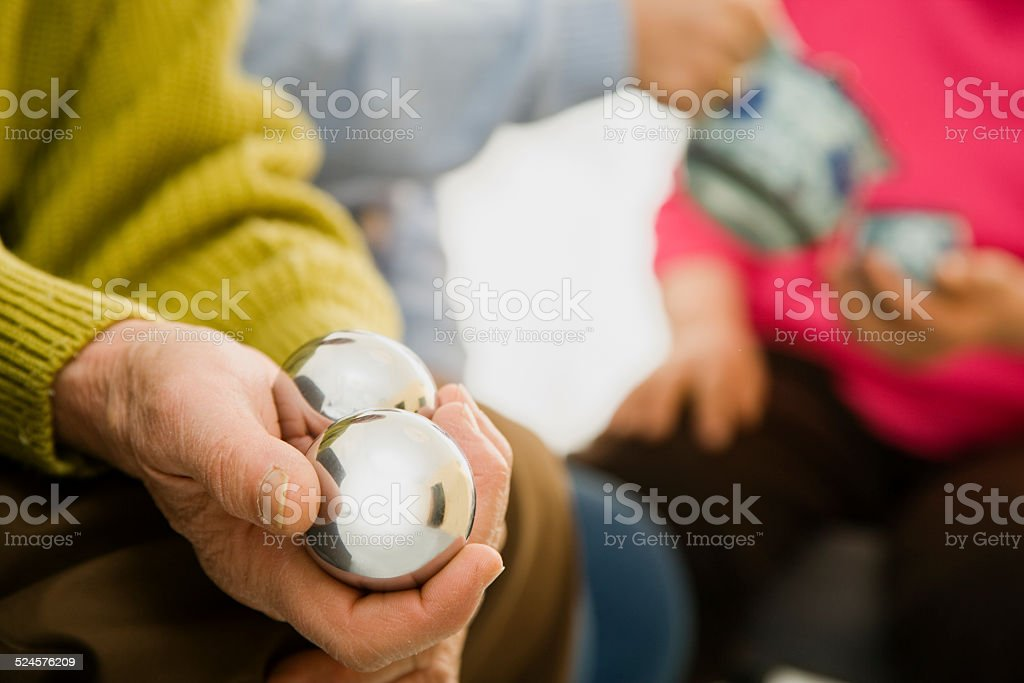 Old man playing Chinese Exercise balls in hand stock photo