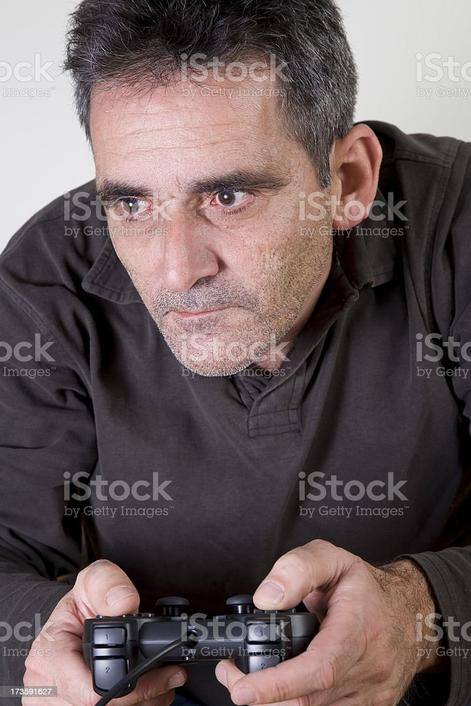 old man playing video game royalty-free stock photo