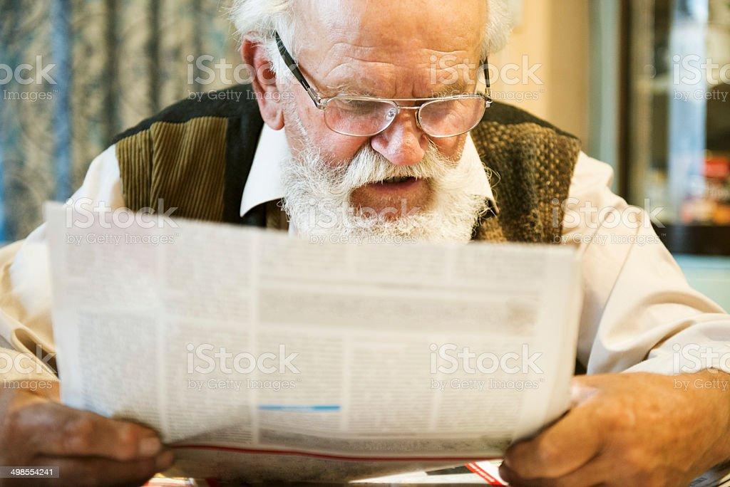 Old man reading stock photo