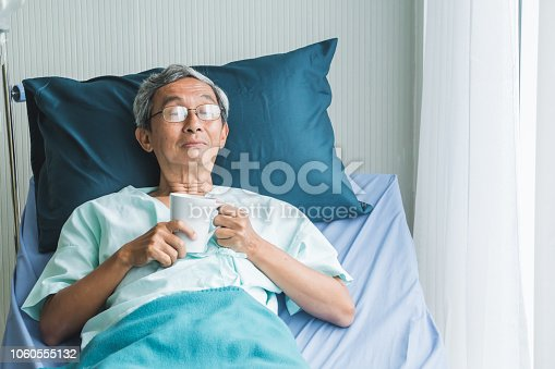 840514774istockphoto Old man rest in hospital with hope 1060555132