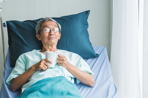1049772134 istock photo Old man rest in hospital with hope 1060555132