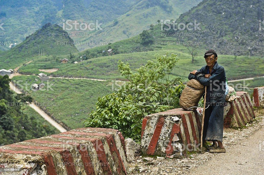 Old Man Resting on Vienam Mountain Road stock photo