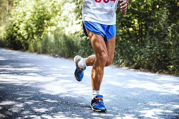 old man runs marathon - old man feet stock photos and pictures