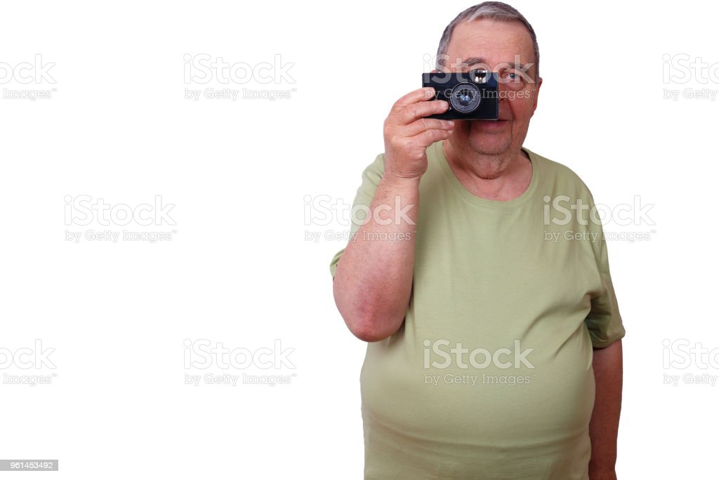 Old man satisfied man taking picture with retro film camera, iso stock photo