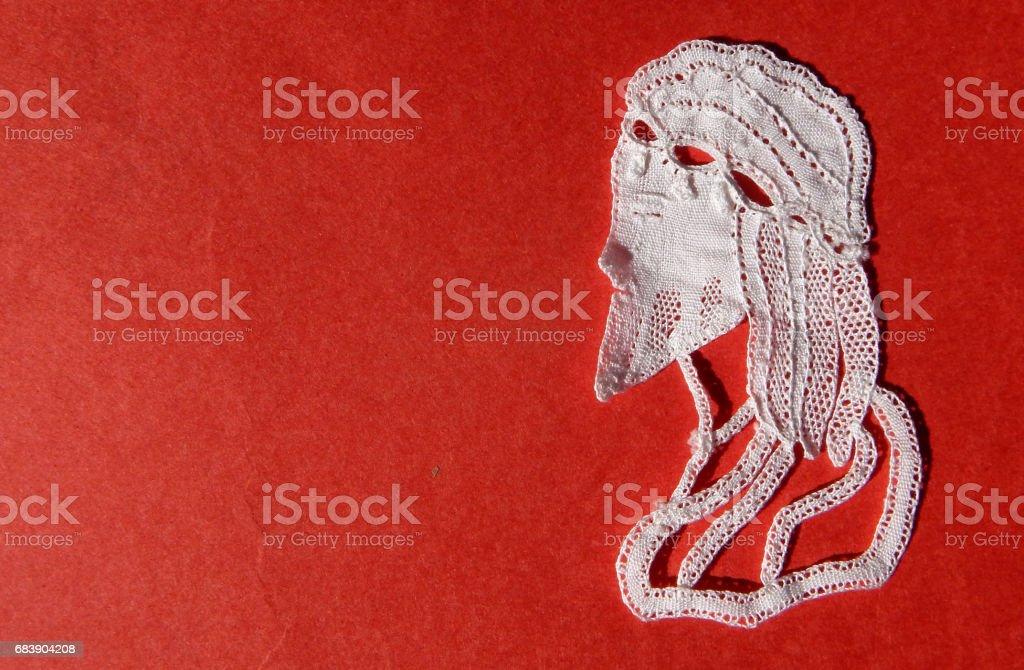 old man shape Lace work on textile background stock photo