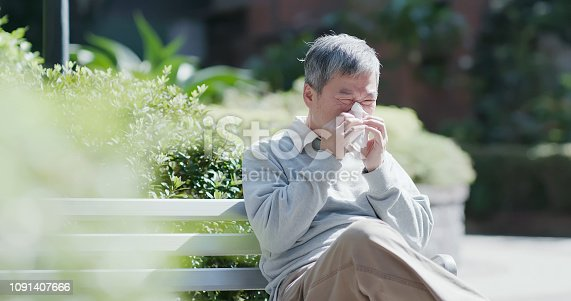 istock old man sick and sneeze 1091407666