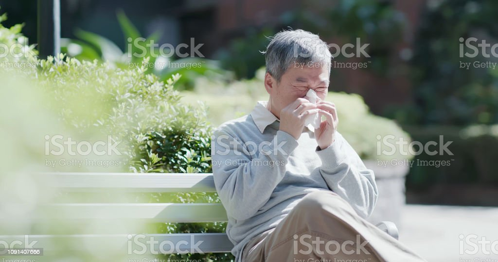 old man sick and sneeze stock photo