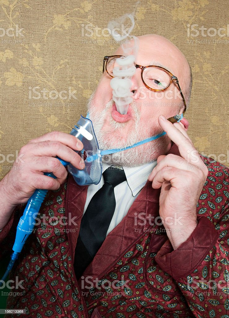 Old man sick for smoke stock photo