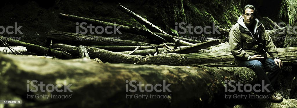 Old Man Sitting in Fallen Forest royalty-free stock photo