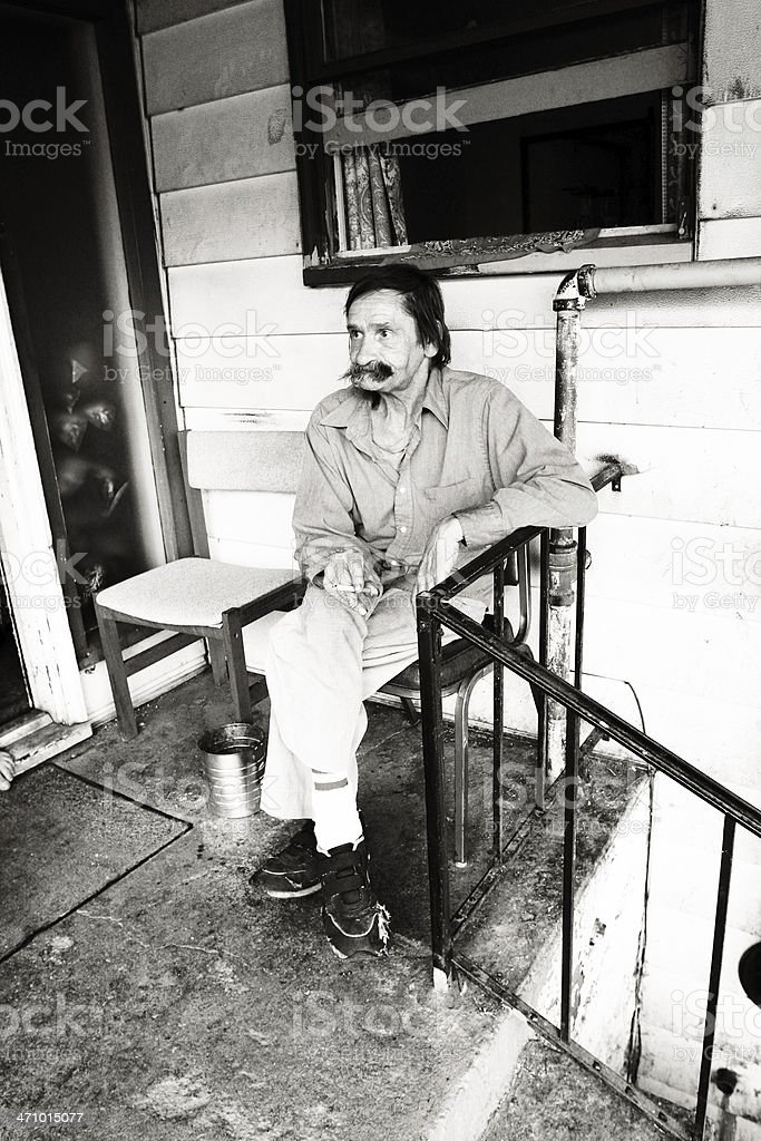 Old Man Sitting on a Porch royalty-free stock photo