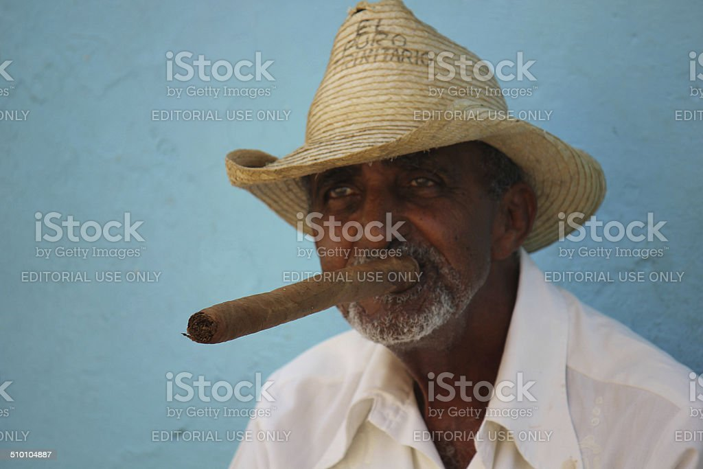 Old man smoking a typical cuban cigar stock photo