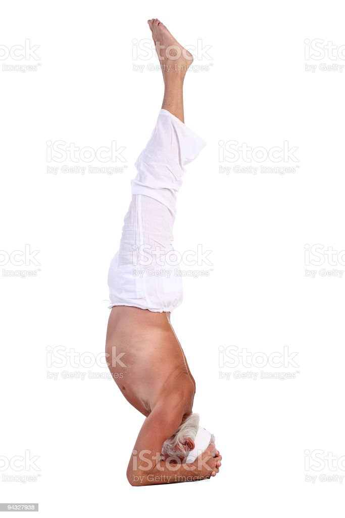 Old man standing on head. royalty-free stock photo