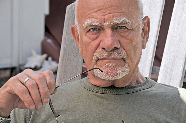 old man stares - mike cherim stock pictures, royalty-free photos & images