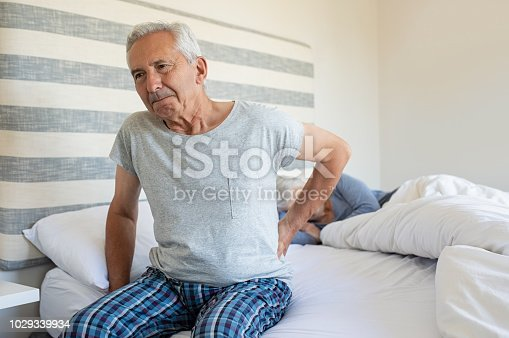 istock Old man suffering back pain 1029339934