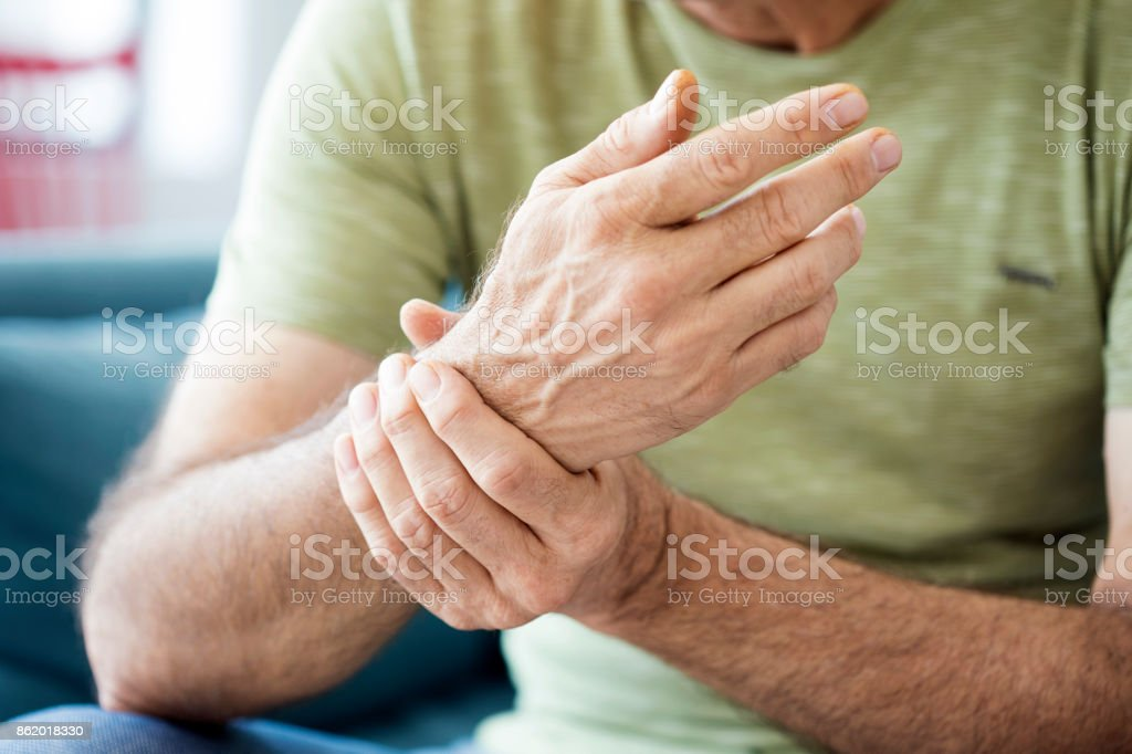 Old man suffering from pain and rheumatism royalty-free stock photo