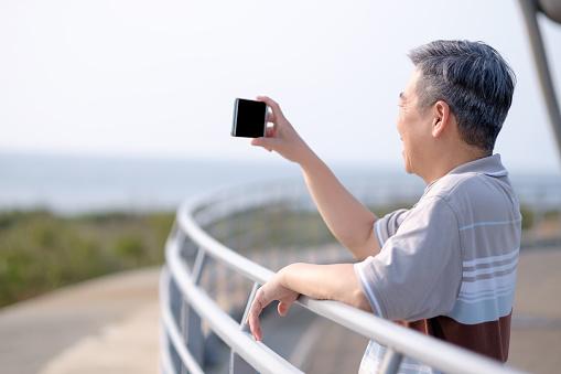 old man take selfie