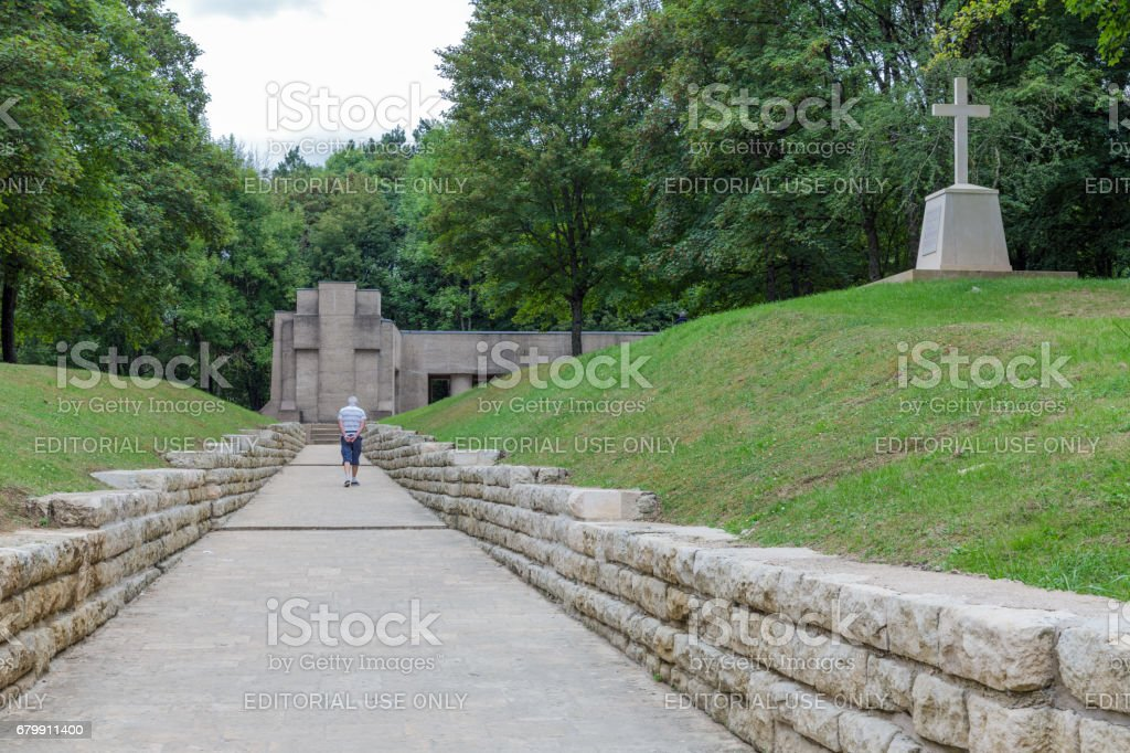 Old man visiting WW1 memorial Trench of Bayonets at Douaumont – zdjęcie