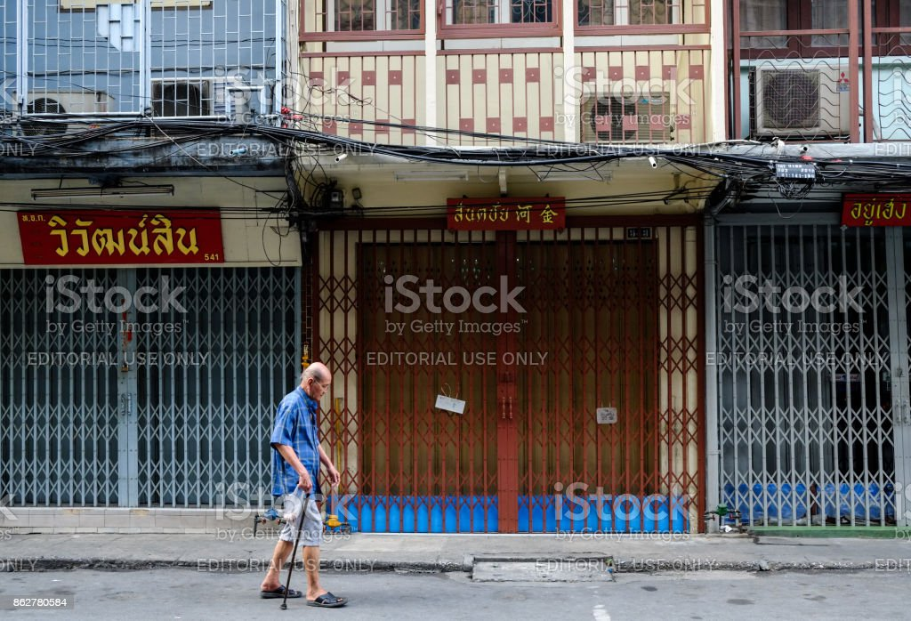 Old Man Walking, Bangkok, Thailand stock photo