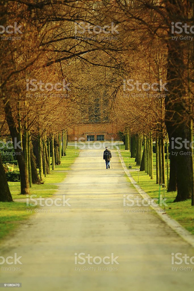 Old man walking down the alley royalty-free stock photo