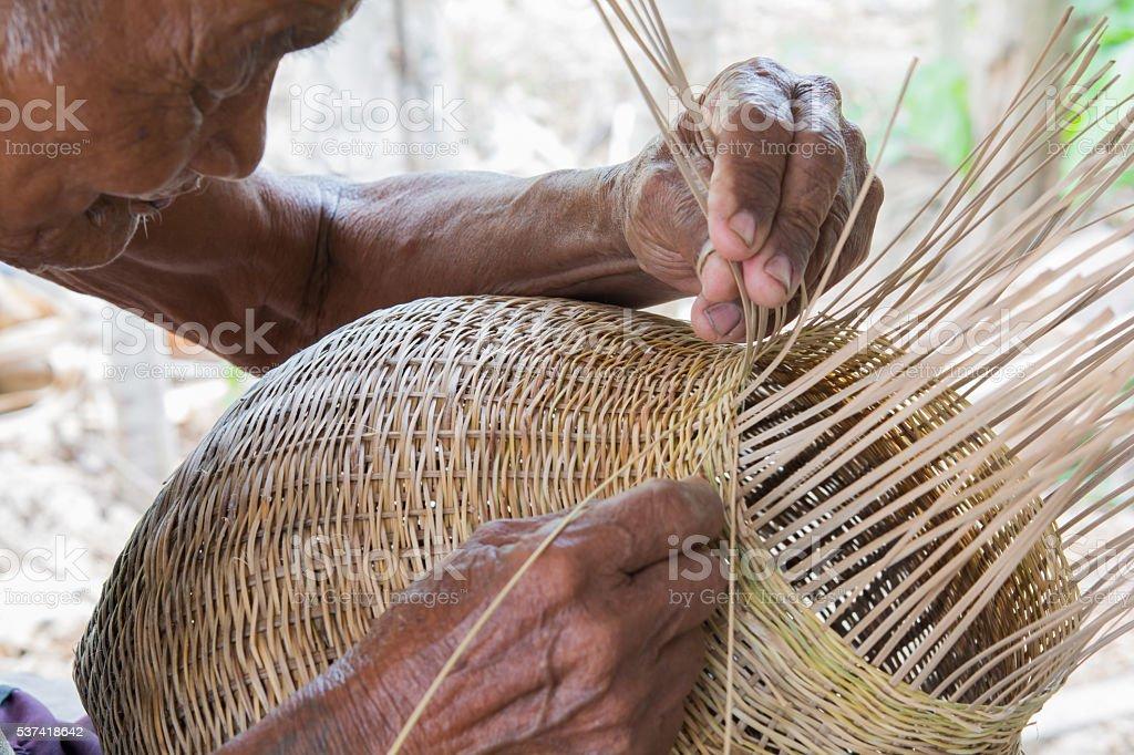old man wicker bamboo basket stock photo
