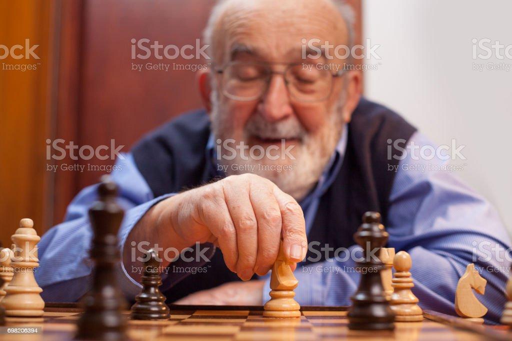 old man winning chess match stock photo