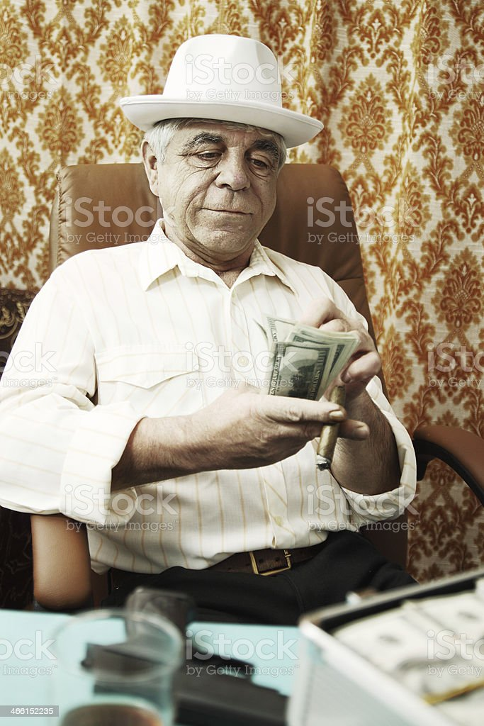 old man with a cigar stock photo