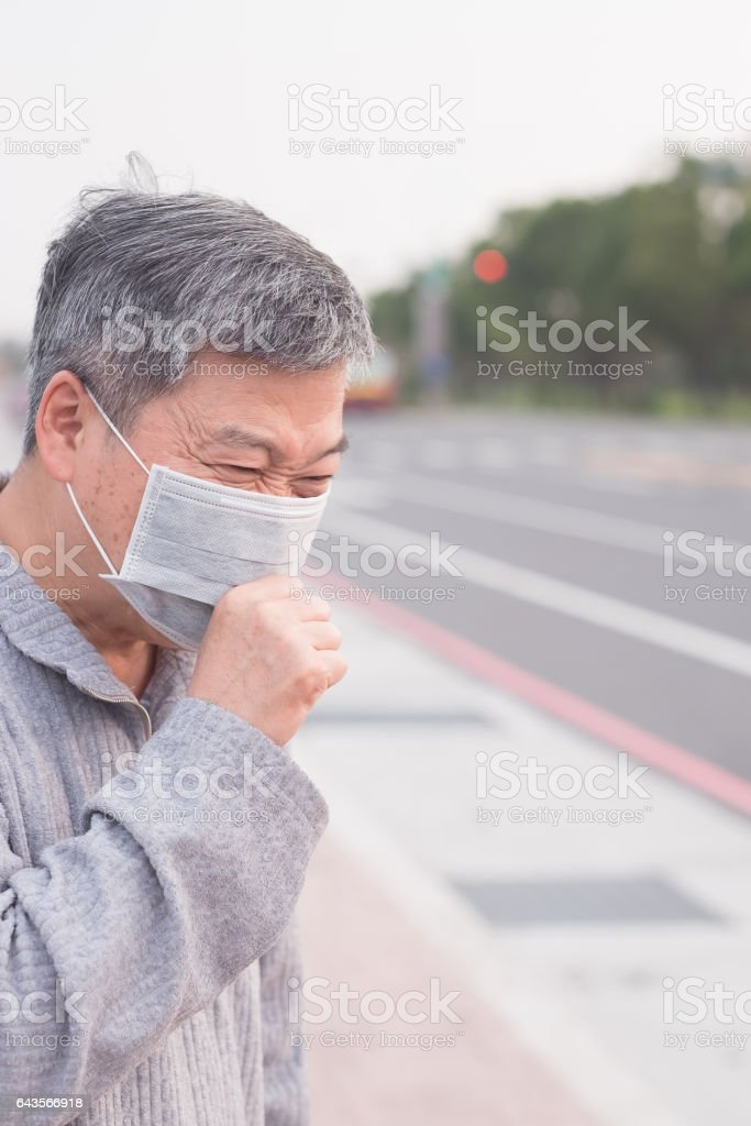 old man with air pollution stock photo