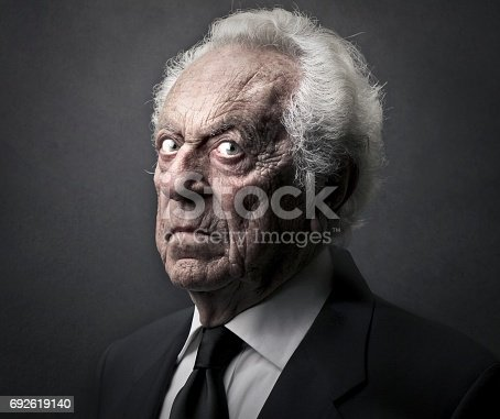 istock Old man with an evil look 692619140