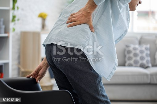 821012164istockphoto Old man with back pain 821012164