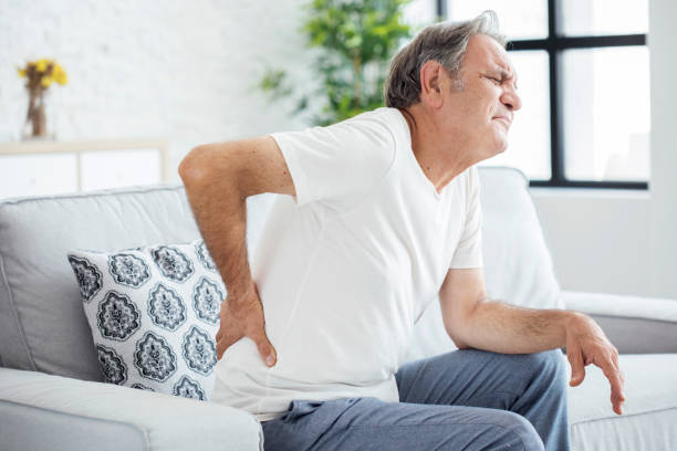 Old man with back pain stock photo