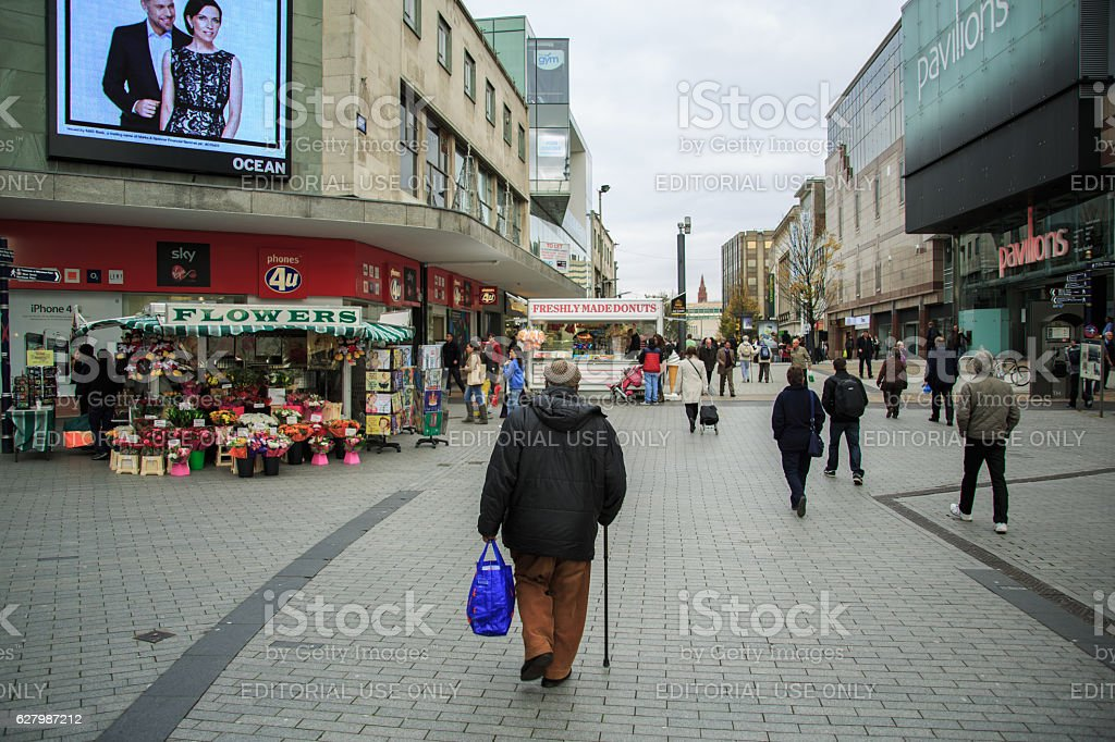 Old man with blue shopping bag stock photo