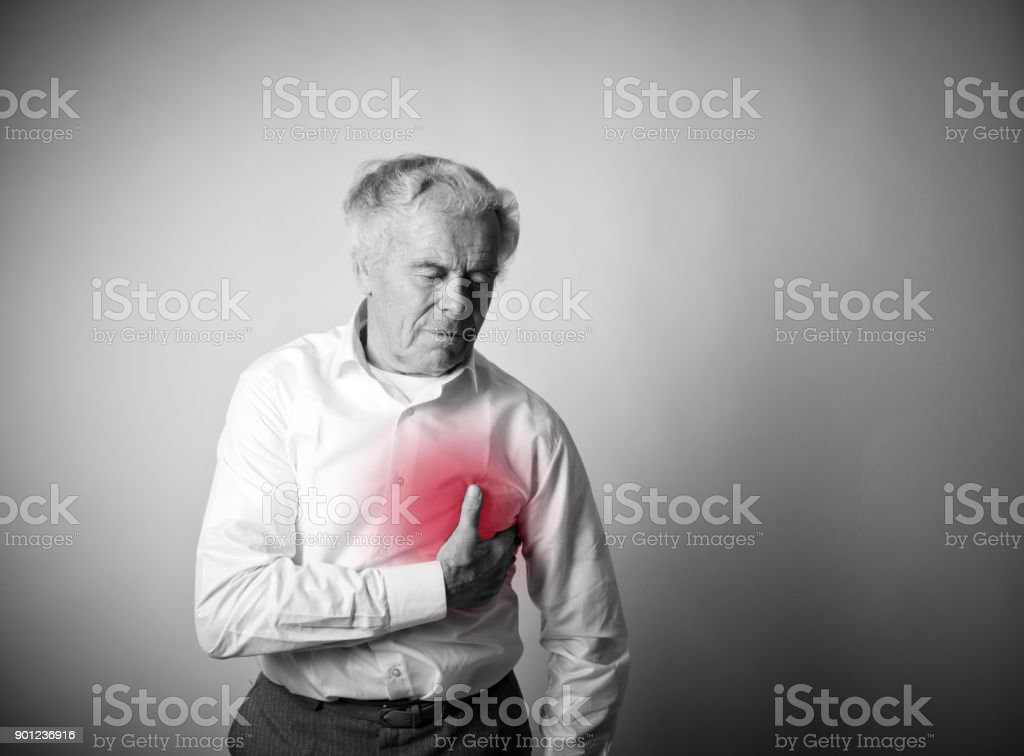Old man with chest pain suffering from heart attack. stock photo