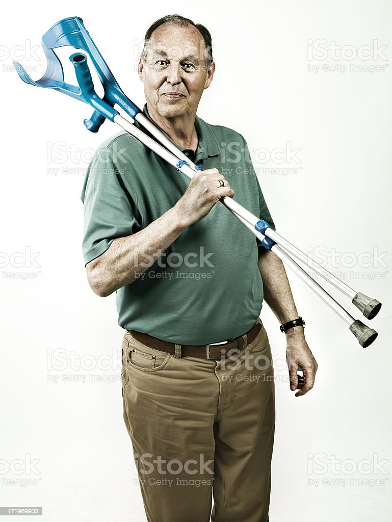 old man with crutches stock photo