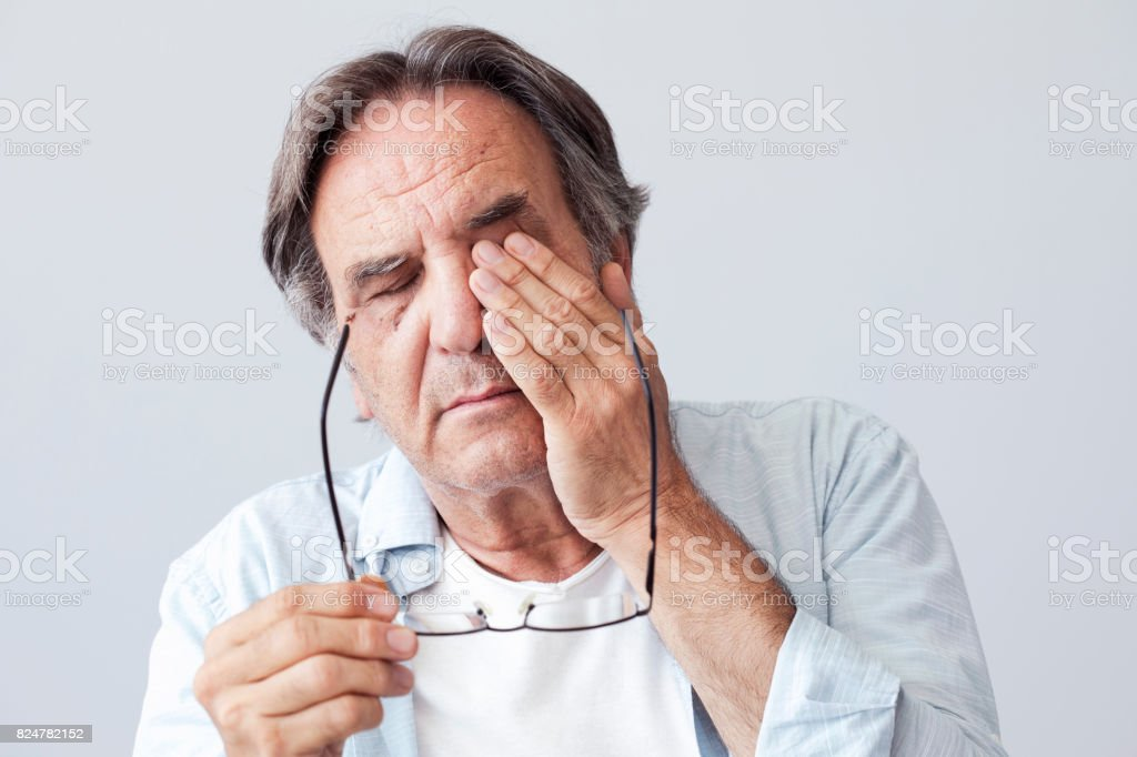 Old man with eye fatigue royalty-free stock photo