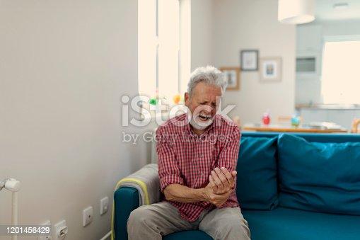 Man massaging his arthritic hand and wrist