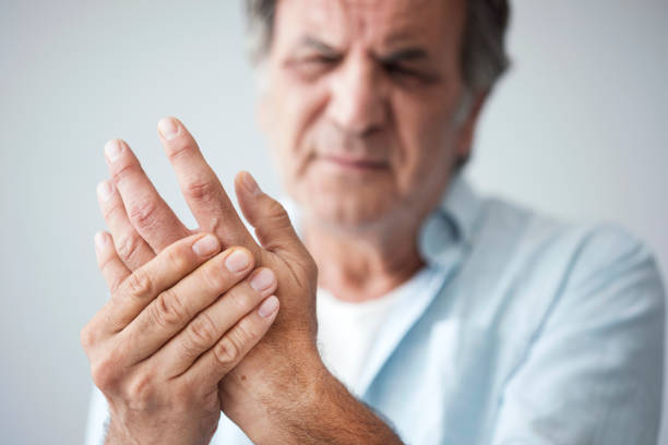 Old man with finger pain stock photo