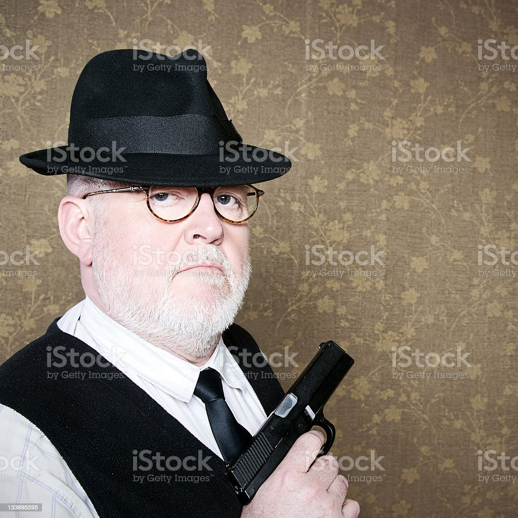 Old man with gun stock photo