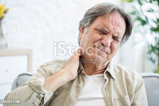 istock Old man with neck pain 821011766
