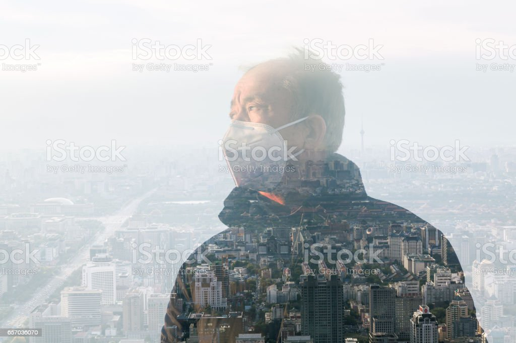 old man with respirator in the mist stock photo