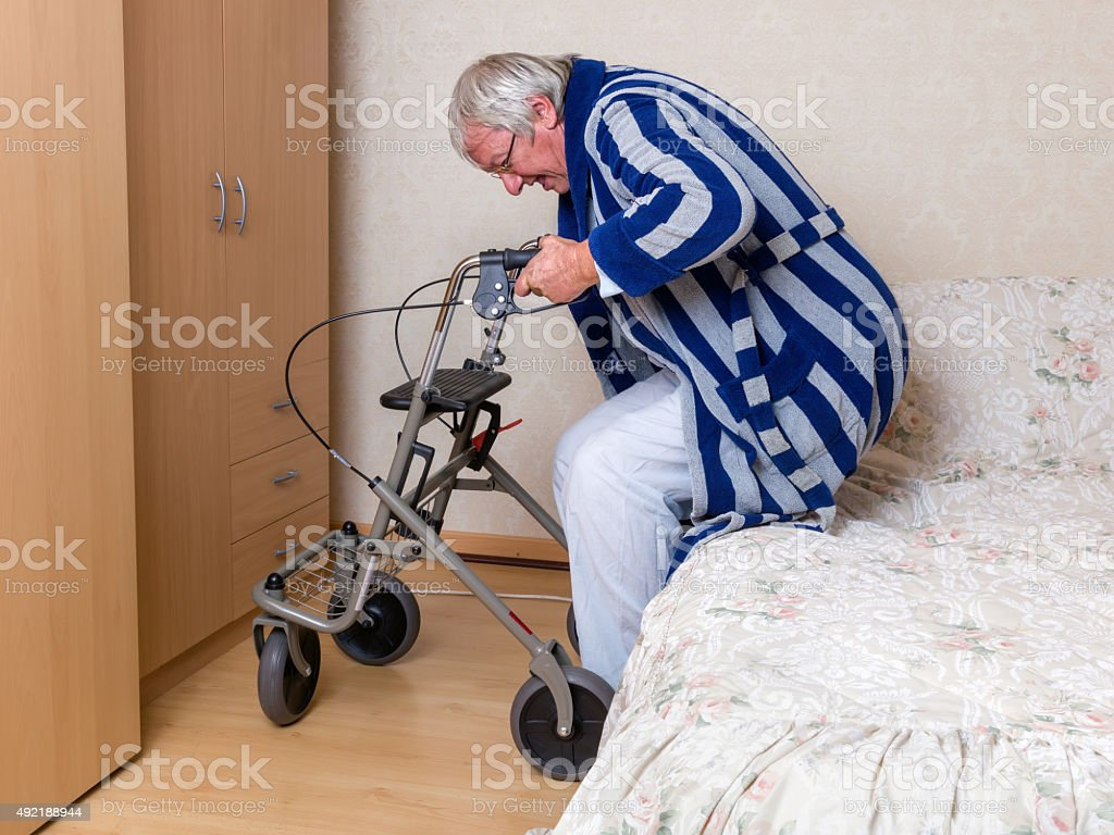 Old man with rollator stock photo