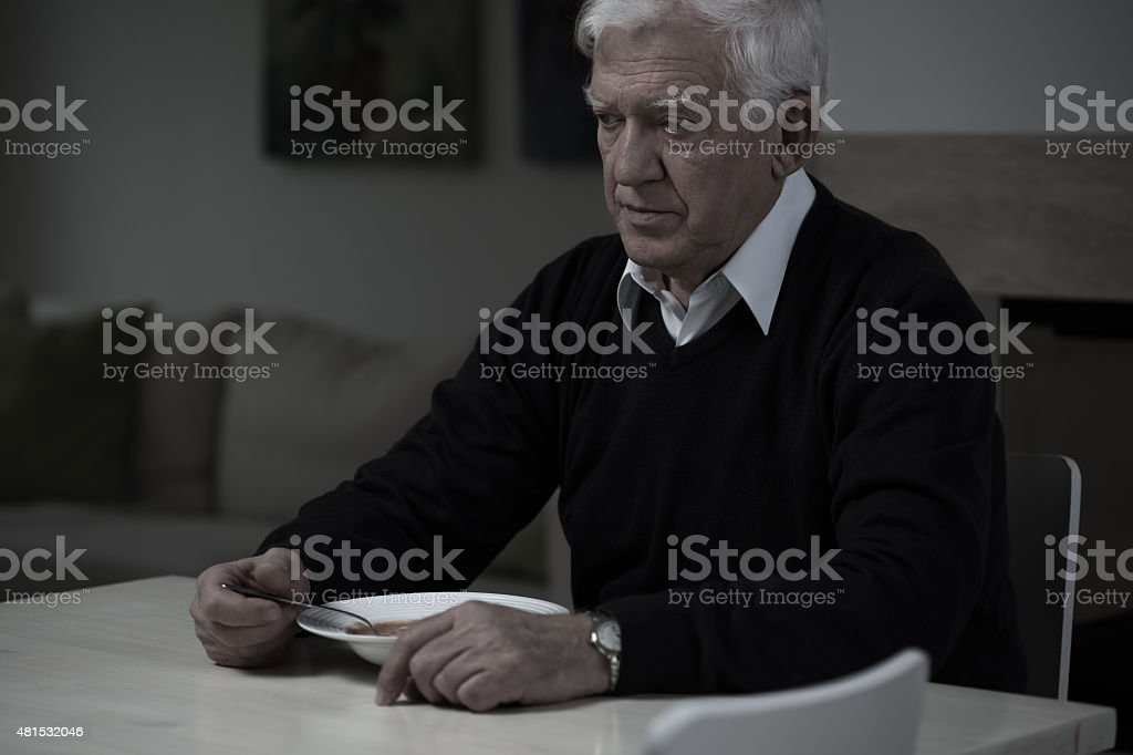 Old man without appetite stock photo
