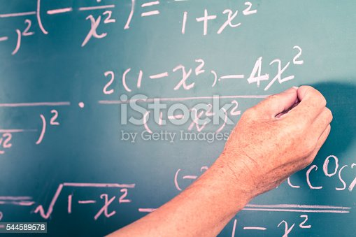 istock old man writing complex math equations 544589578