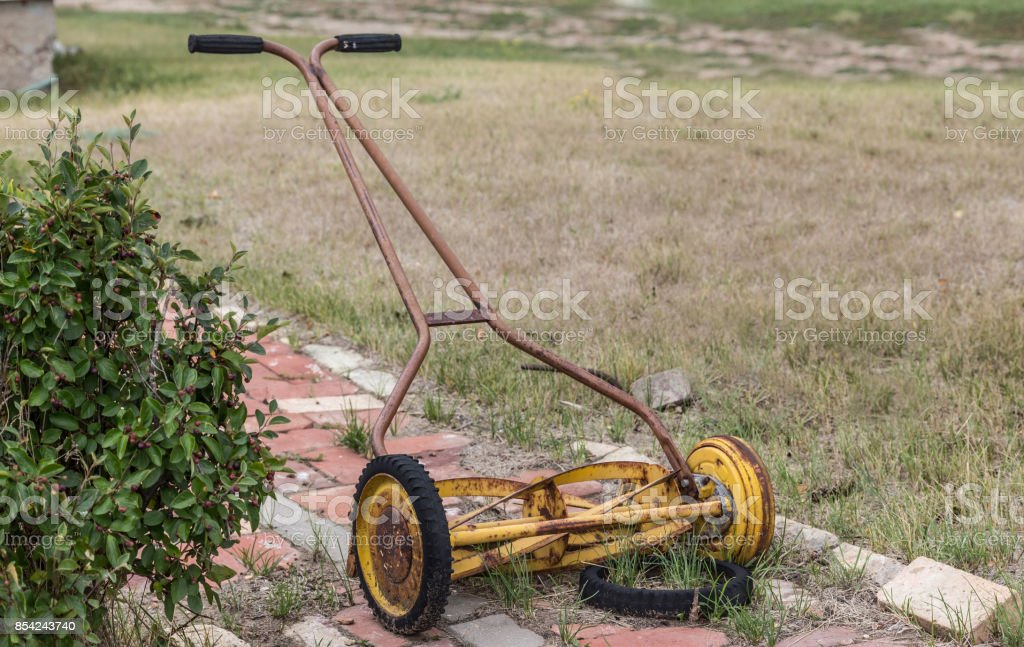 old manual push lawn mower. stock photo