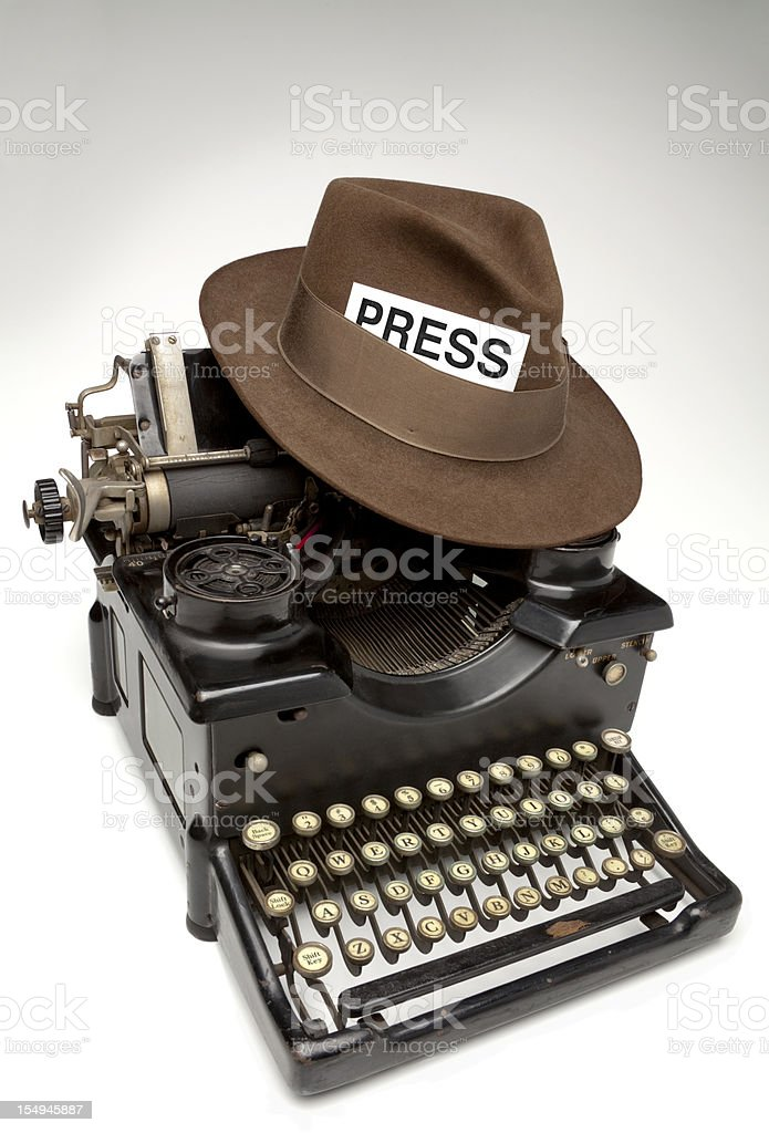 Old Manual Typewriter and Reporter's PressPass in Hat, White Background. stock photo