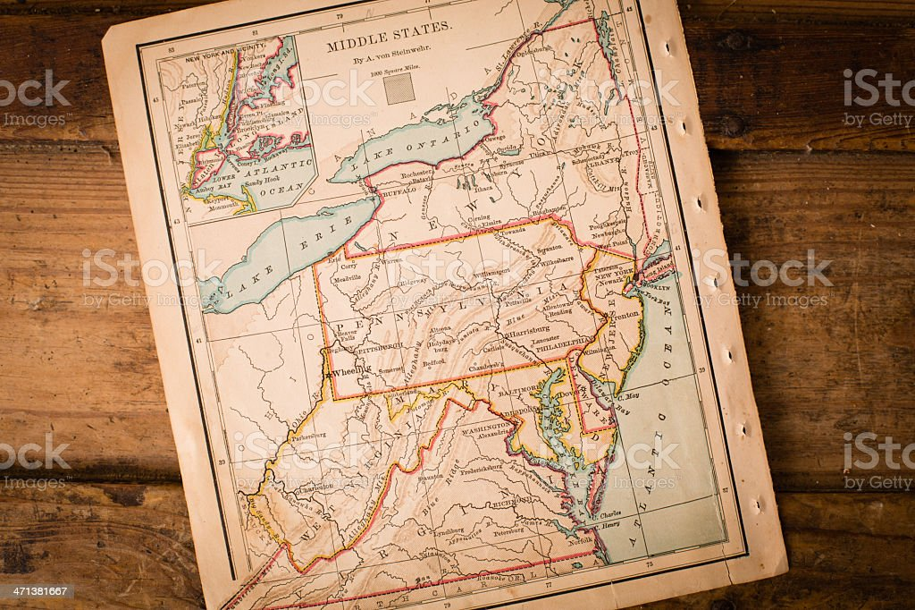 Old Map of Middle States, Sitting Angled on Wood Trunk stock photo