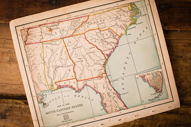 old, map of south eastern states, sitting angled on trunk - charleston sc map stock photos and pictures